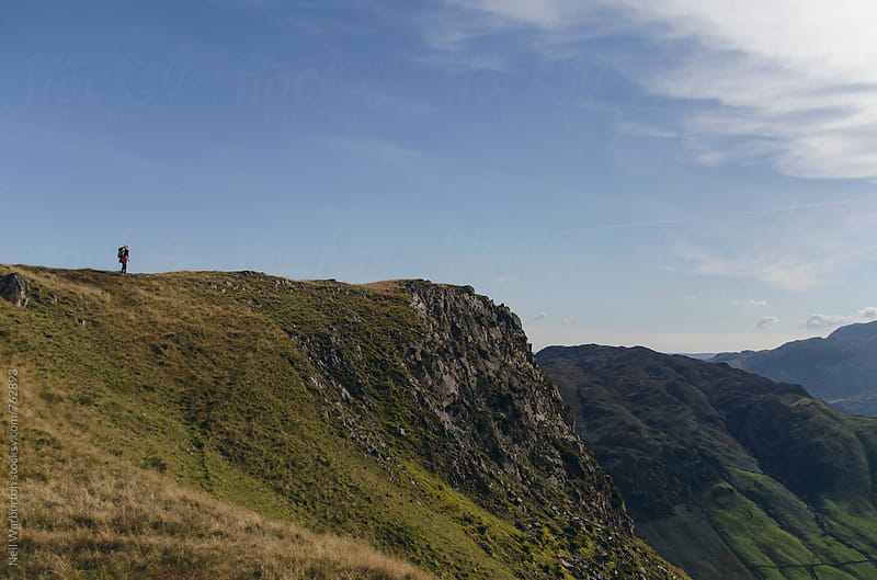 Distant Hiker in the Lake district by Neil Warburton for Stocksy United