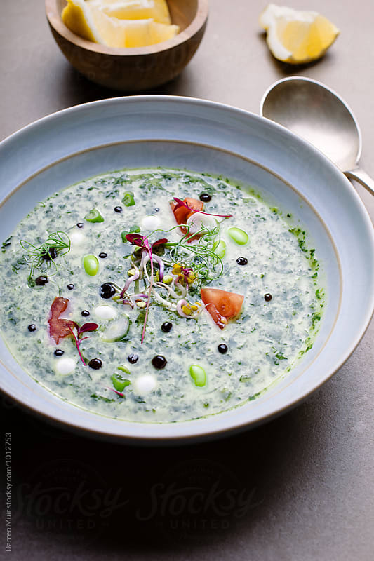 Green gazpacho with balsamic caviar. by Darren Muir for Stocksy United