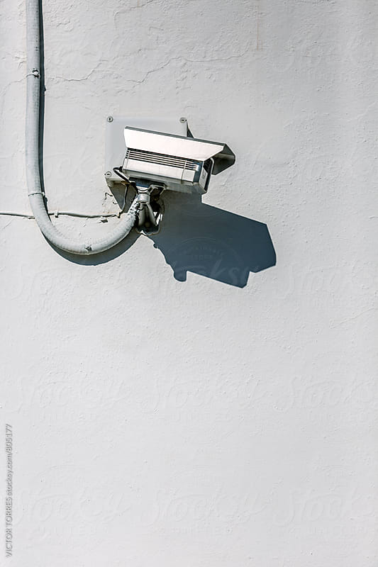 Security Camera on a White Wall by VICTOR TORRES for Stocksy United