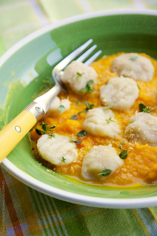 Celery root gnocchi with an apple carrot sauce by Harald Walker for Stocksy United