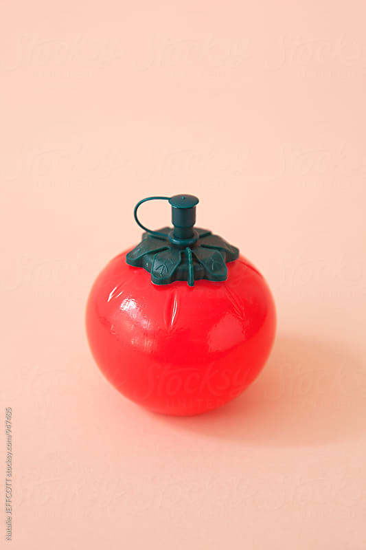 Retro tomato ketchup / sauce dispenser by Natalie JEFFCOTT for Stocksy United
