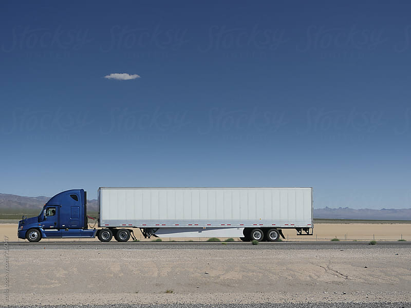truck driving through desert on the highway by rolfo for Stocksy United
