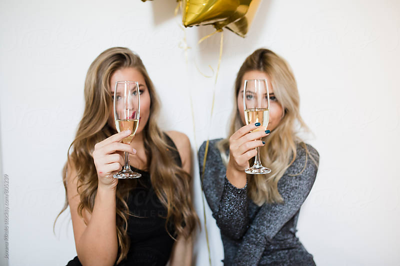 New Year's Eve; Two female friends having fun at the party by Jovana Rikalo for Stocksy United