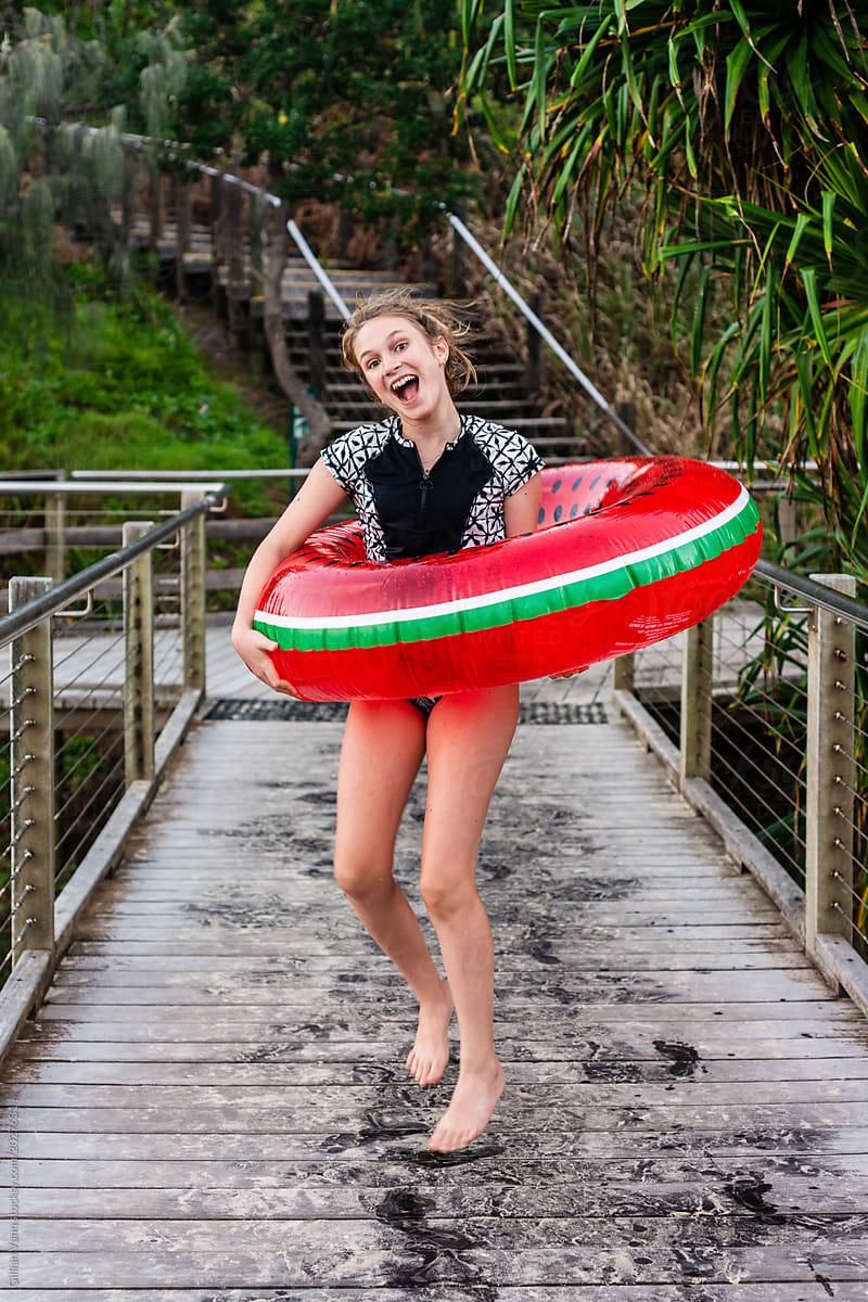 02e1c1e0d6f9 teen girl with watermelon inflatable tube by Gillian Vann for Stocksy United