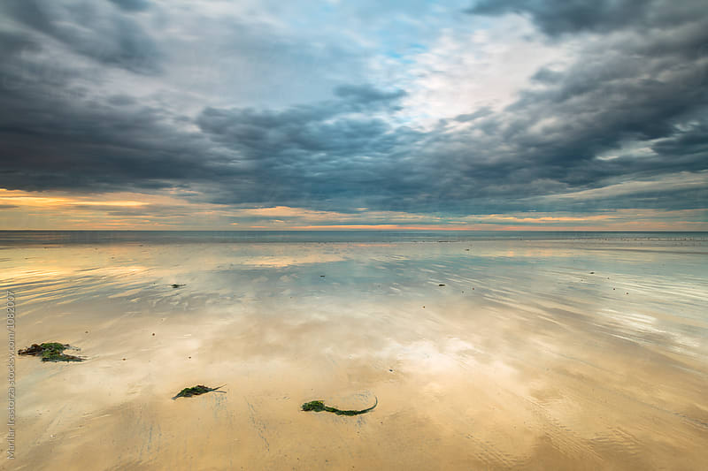 Beach at low tide at sunset by Marilar Irastorza for Stocksy United