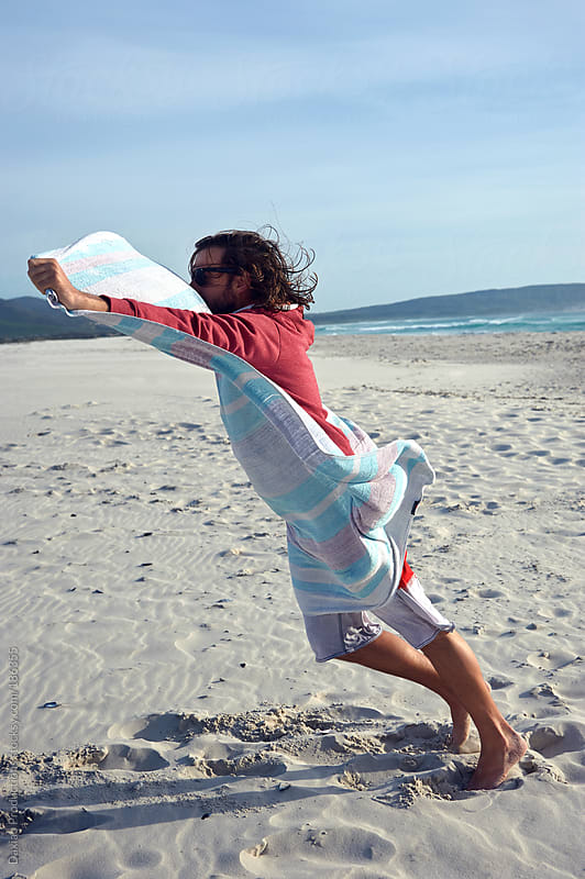 windy beach man by Daxiao Productions for Stocksy United