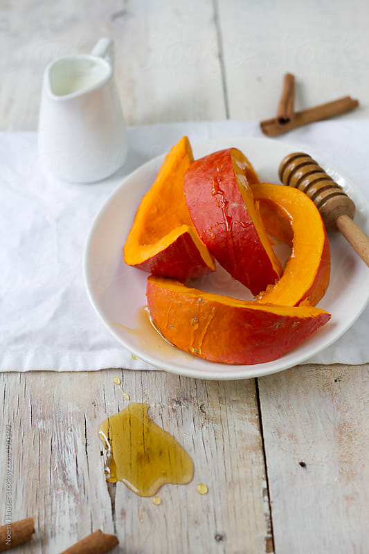 Pumpkin slices with honey by Noemi Hauser for Stocksy United