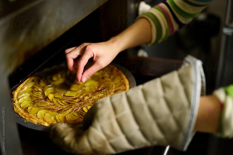 Chef's hand testing prepared sweet potatoes pie by Lawren Lu for Stocksy United