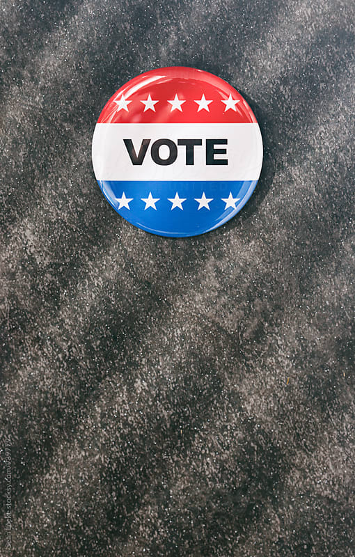 Vote: Patriotic Vote Pin On Dark Shadow Background by Sean Locke for Stocksy United