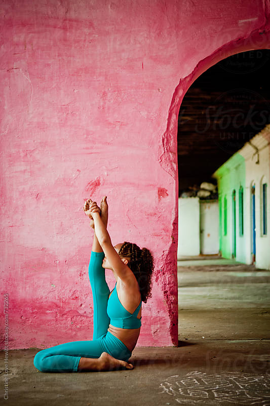 Woman doing yoga by Christine Love Hewitt for Stocksy United