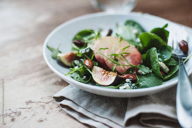 Pear, Fig, and Watercress Salad  by Cameron Whitman for Stocksy United
