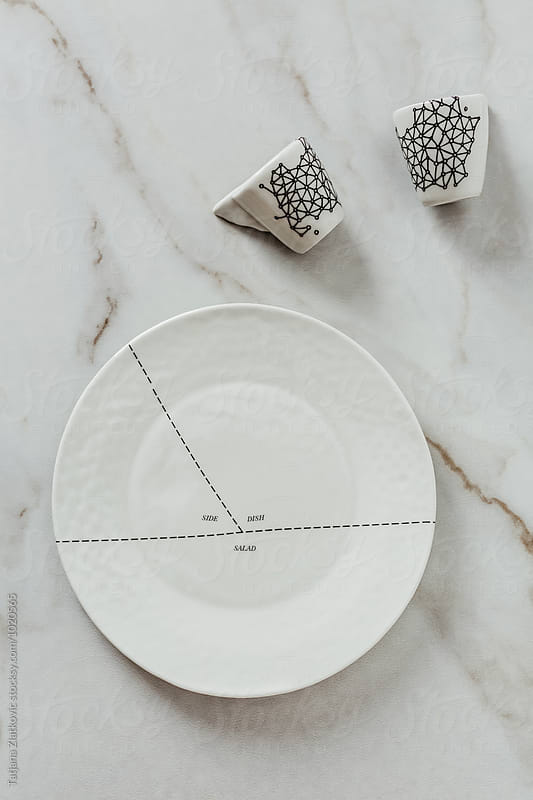 Artistic plate and cups by Tatjana Ristanic for Stocksy United