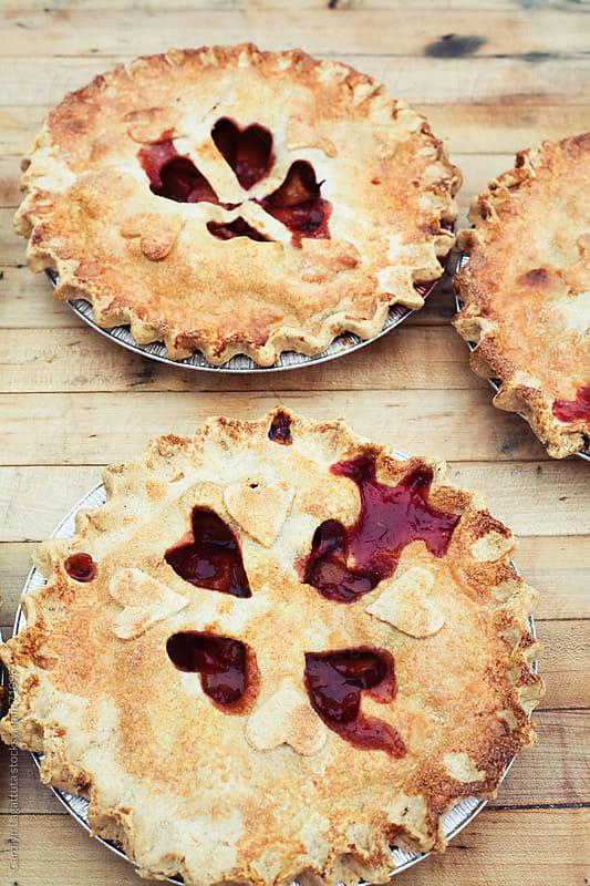 Peach pie with heart cut outs by Carolyn Lagattuta for Stocksy United
