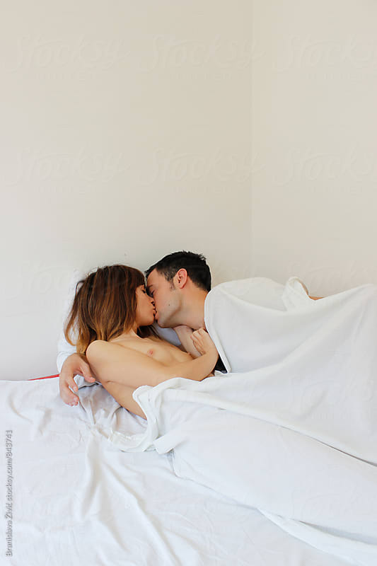 Portrait of a young couple having beautfiul morning in their bed by Branislava Živić for Stocksy United