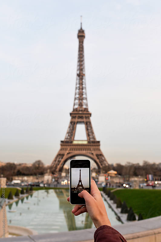Taking photos with a smartphone to Eiffel Tower from Trocadero by Bisual Studio for Stocksy United