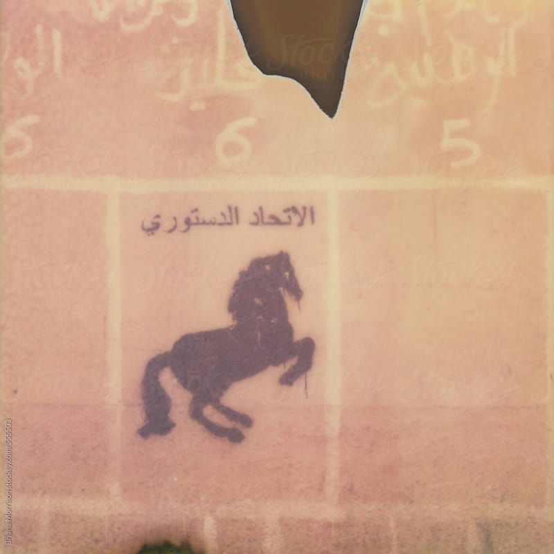 Old Painted Sign with Arabic Text and a Horse by Briana Morrison for Stocksy United