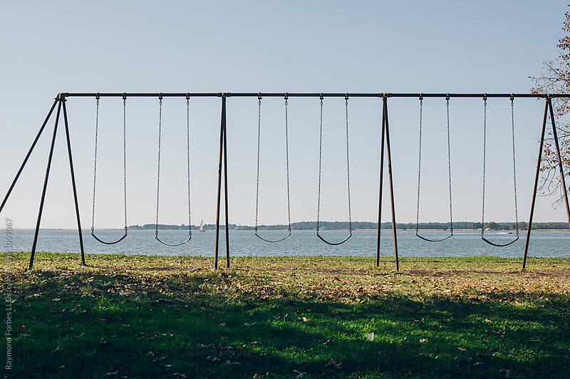 Empty Swingset on Chesapeake Bay in Autumn by Raymond Forbes LLC for Stocksy United