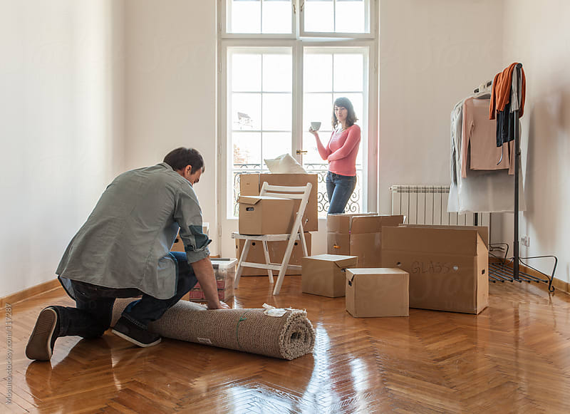 Two People Unpacking in Their New House by Mosuno for Stocksy United