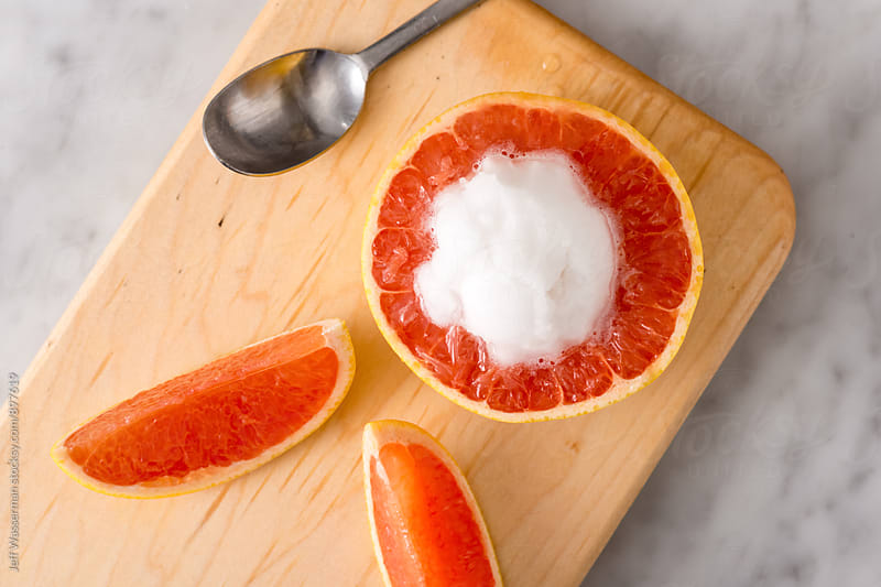 Grapefruit Gelato Sreved in a Grapfruit by Jeff Wasserman for Stocksy United