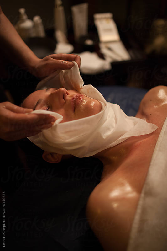 Facial treatment in spa by Leandro Crespi for Stocksy United