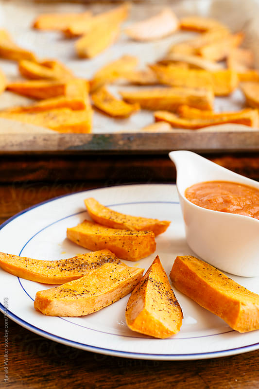 Sweet Potato Fries with Mango Ketchup by Harald Walker for Stocksy United