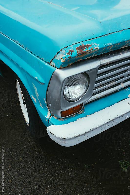 Detail of old vintage pickup truck, focus on headlight by Paul Edmondson for Stocksy United