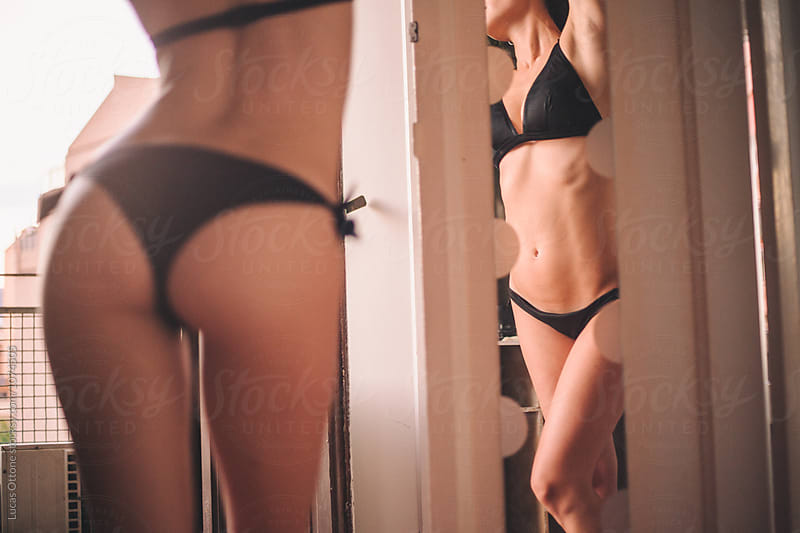 Sexy girl in bikini reflected on a mirror by Lucas Ottone for Stocksy United