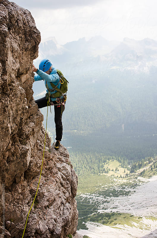 Female alpinist rock climbing Tofana di Rozes route by RG&B Images for Stocksy United
