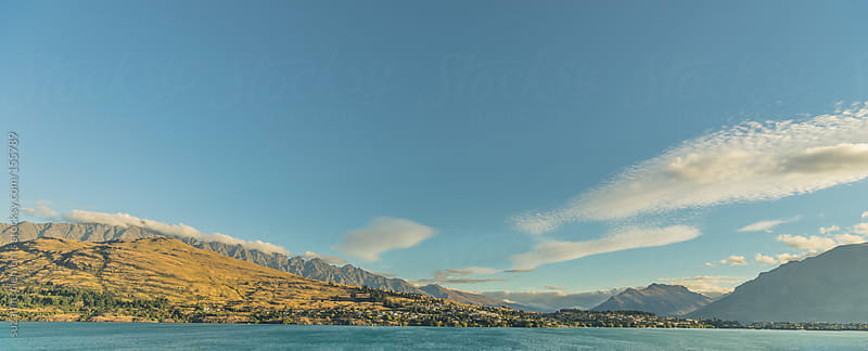 Panoramic View of Mountains, Blue Water, Blue Skies and Sunshine by suzanne clements for Stocksy United