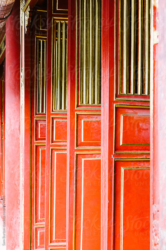 Red doors by Sam Burton for Stocksy United
