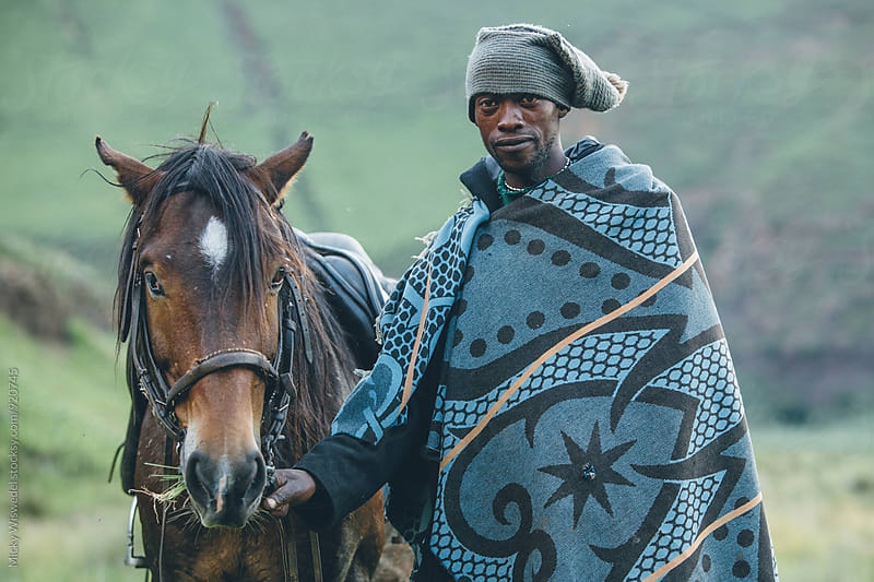 portrait of a Basotho herdsman with his horse by Micky Wiswedel for Stocksy United