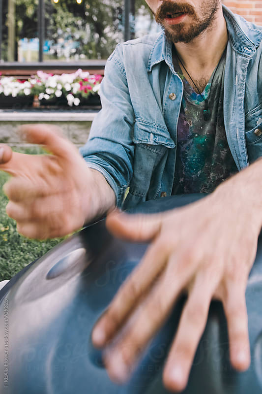 Close up of hand on the handpan by Danil Nevsky for Stocksy United