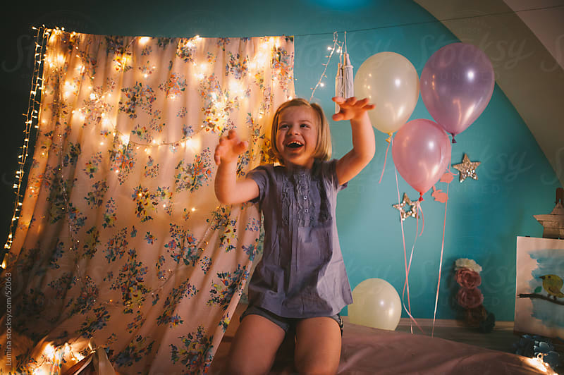 Girl Playing in Her Room by Lumina for Stocksy United