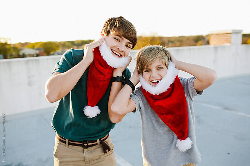 Two boys wearing santa beards by Erin Drago for Stocksy United