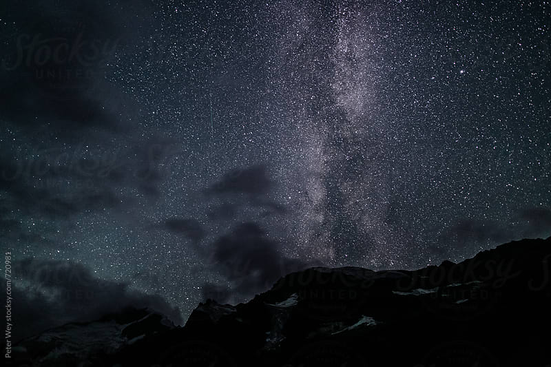 Piz Morteratsch with milkyway by Peter Wey for Stocksy United