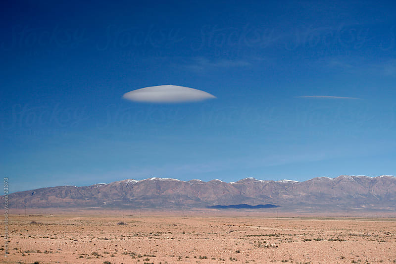 Lenticular cloud and Atlas Mountains in Morocco by Ferenc Boros for Stocksy United