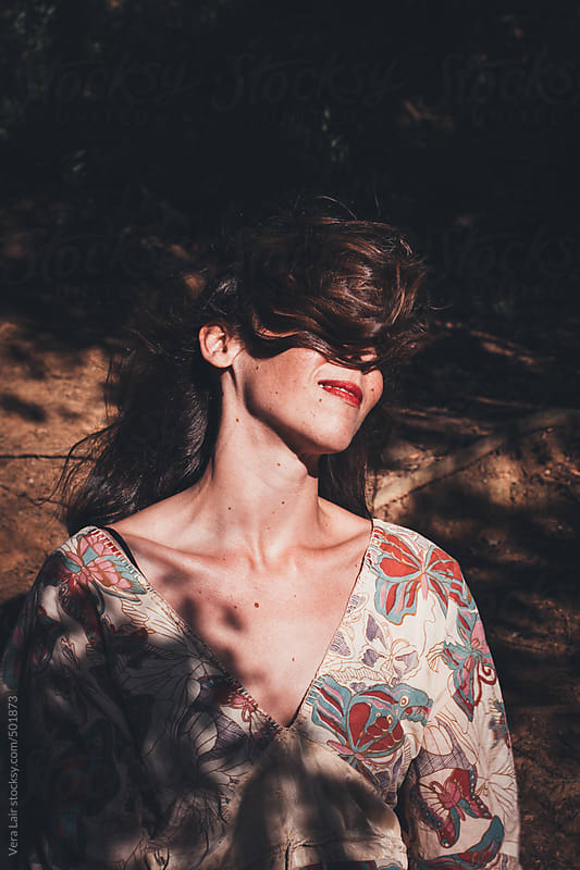 woman in a sunbeam by Vera Lair for Stocksy United