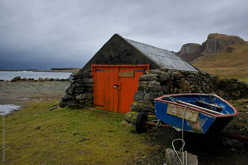 Old hut and boat at the Scottish coast  by Melanie Kintz for Stocksy United