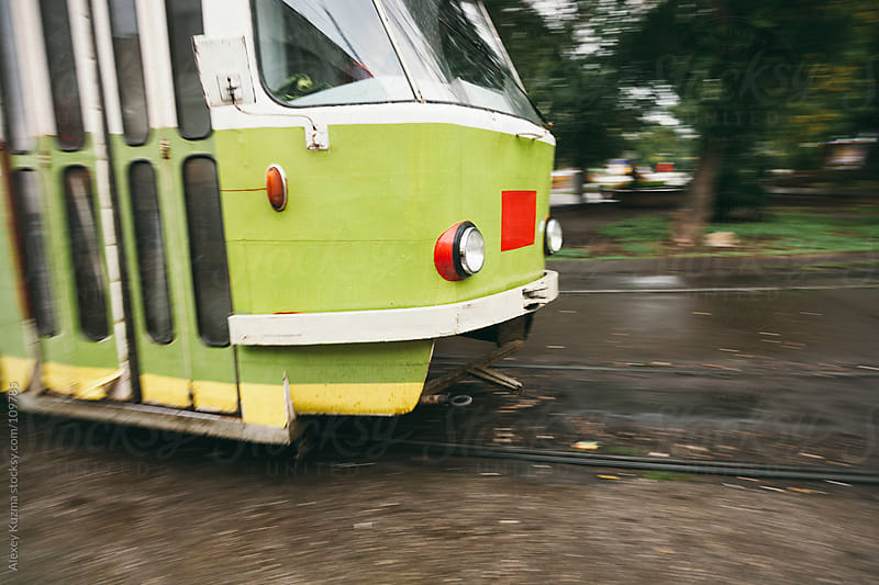 Motion blurred green tram by Alexey Kuzma for Stocksy United