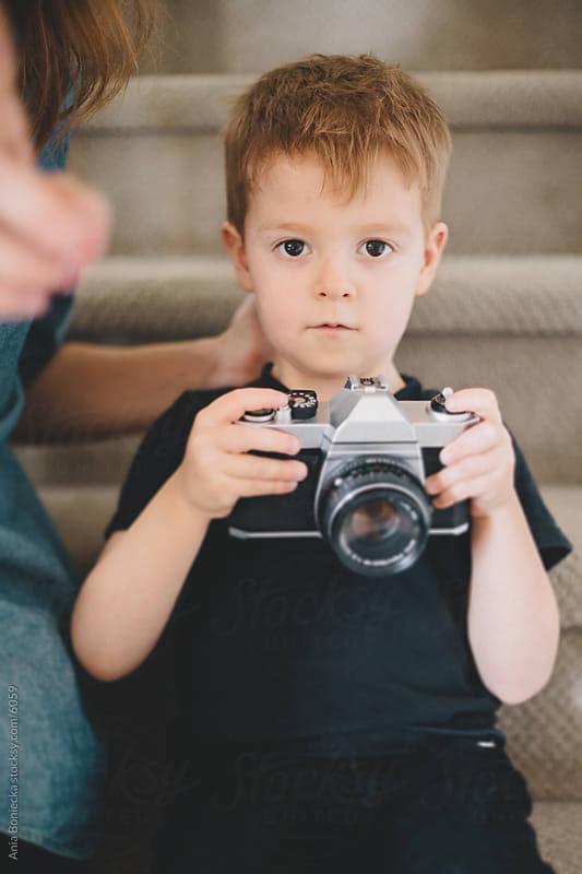 A boy holding a camera by Ania Boniecka for Stocksy United