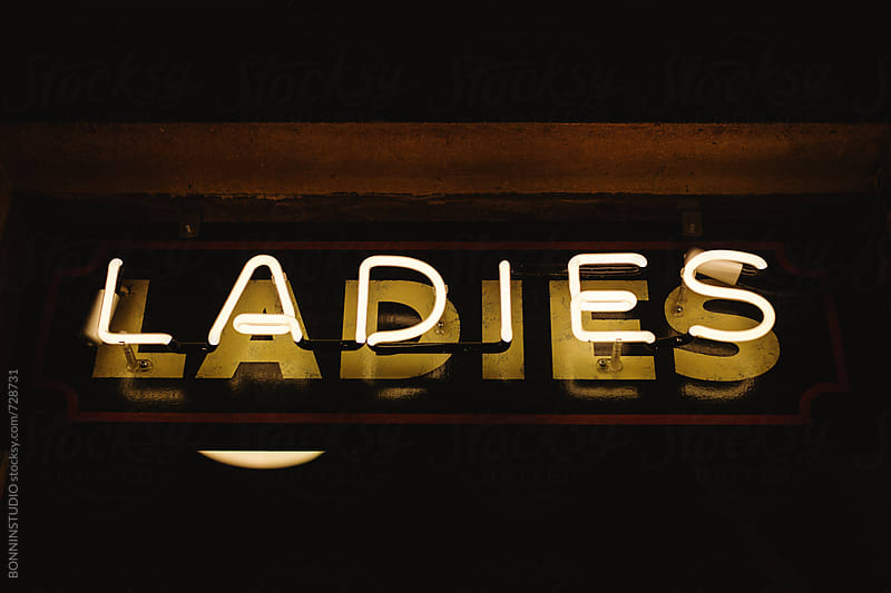 Neon sign: ladies restroom.  by BONNINSTUDIO for Stocksy United