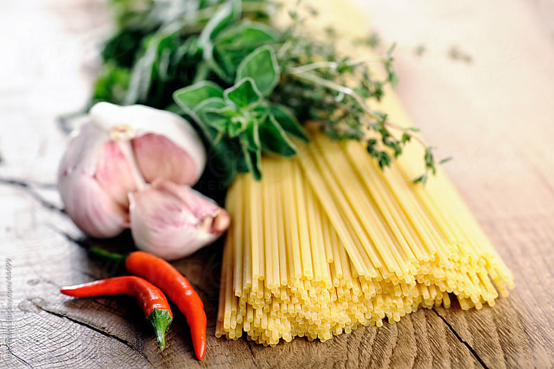 Food: Pasta ingredients, Spagghetti, Oregano, Thyme, garlic and chilli by Ina Peters for Stocksy United