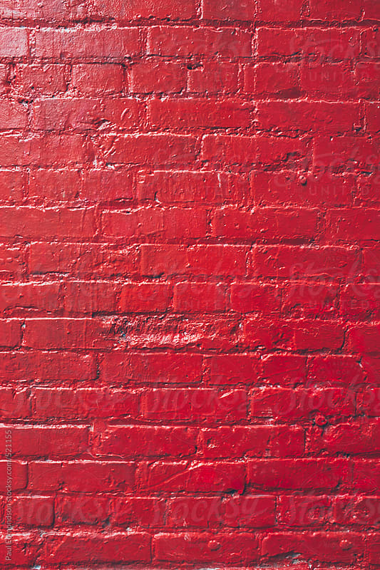 Painted red brick wall by Paul Edmondson for Stocksy United