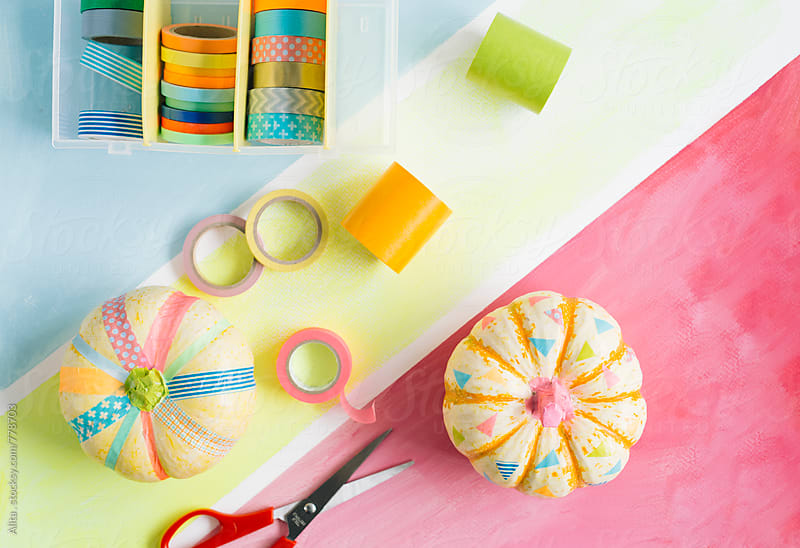 DIY cute pumpkins decorated with colourful washi tapes by Alita Ong for Stocksy United