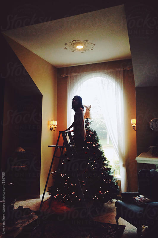 Decorating the tree by luke + mallory leasure for Stocksy United