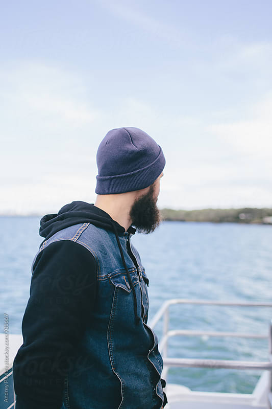 Man with beard looking back by Andrey Pavlov for Stocksy United