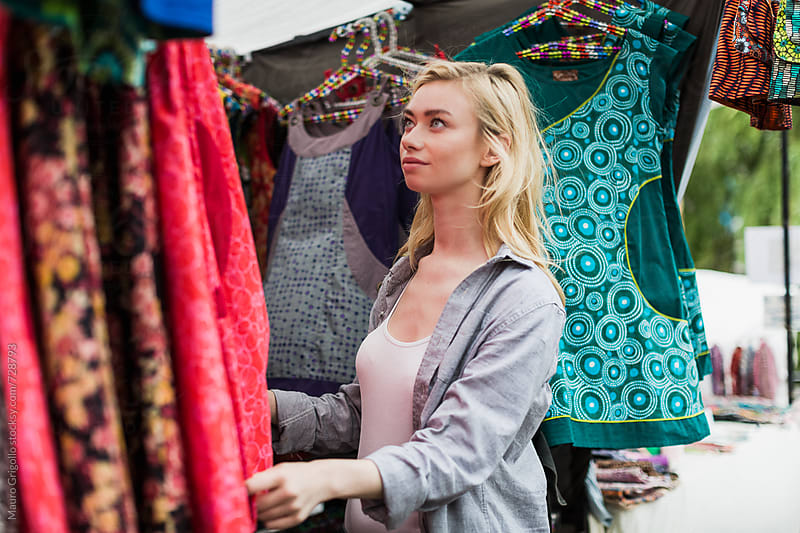 Young woman during shopping at the market by Mauro Grigollo for Stocksy United