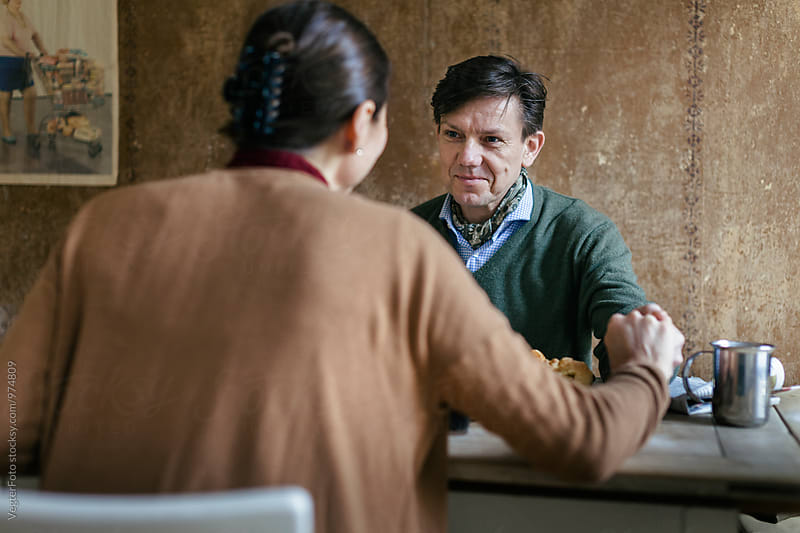 Mature Couple enjoying breakfast by VegterFoto for Stocksy United