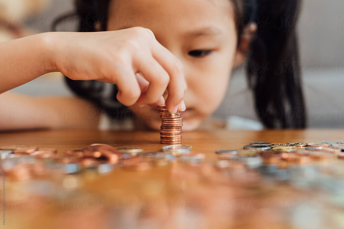 Stock Photo - Little Girl Counting Coins