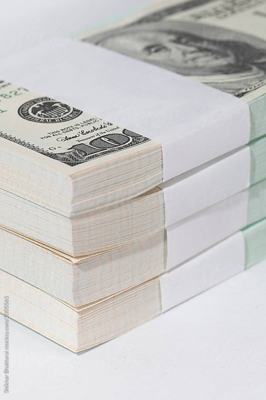 close up of stack of us dollars. by Shikhar Bhattarai for Stocksy United